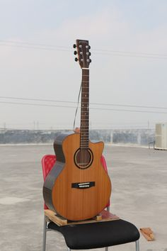 """$109 Model:W-MDS-41A Name:41"""" Solid Top cutaway Acoustic Guitar Top:A+ Solid Cedar Back & Side:Rosewood Laminated Binding:Wood Back Seam:Wood Rosette:Wood Finish:High-gloss Color:Nature Neck Material:Nato Fingerboard:Rosewood with Inlay Abalone Shell Dot Fret:20 Nut:Bone Nut Width:1 3/4"""" (43mm) Bridge:Rosewood Head machine:High Quality Black Die-cast Saddle:Bone Strings:D'Addario EXP 16 Electronics:As you requested Avaliable Service:Wholesale/ODM/OEM"""