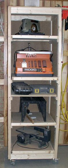 Tool tower: Smaller tools mounted on dedicated tops that you can move to a single universal base cabinet when in use.: