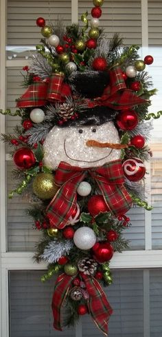This arrangement is hand-crafted using pine and flocked pine sprays. The centerpiece of the design is an adorable snowman, complete with a