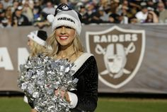 Oakland Raiders cheerleaders perform during the first half of an NFL football game between the Oakland Raiders and the Buffalo Bills in Oakland, Calif., Sunday, Dec. 21, 2014. (AP Photo/Marcio Jose Sanchez)