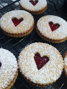 Super cute- really want to make these. Could make them Christmassy by cutting a tree into the middle or something. Maude and Betty: Coconut and Jam Hearts - Christmas baking Yummy Treats, Sweet Treats, Yummy Food, Holiday Treats, Christmas Treats, Christmas Recipes, Jam Cookies, Linzer Cookies, Sandwich Cookies
