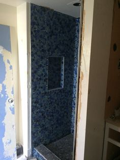 phase 1 shower niche wall (had to go with thinner drywall behind it to fit the depth (see entry closet photo). Schluter (sp?) trim everywhere helps work with crazy shapes and gives an art deco feel