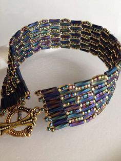 Blue herringbone hand-beaded band by BeadALittleDream on Etsy