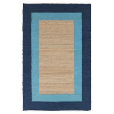 Pairing natural style with a pop of color, this hand-woven jute rug showcases a contrasting border in bright cerulean.      Produ...