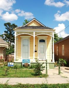 """New Orleans -- example of a  """"shotgun"""" house. Typically, one room in front, opens up to the next, and then the next, on down the line."""