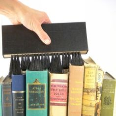 Book Brush: I could really use this for my bookcase filled with photo albums which are embedded with dust.