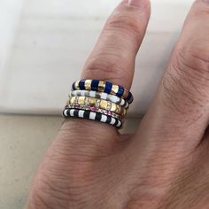 One of my favorite ring, the Siena named after the Siena Cathedral, which is known for its striped marble marble inlaid mosaics. Over the seasons I've been trying to explore creative ways to make stripes with different materials, whether, it is enameled, inlaid or set. I love this particular stack showcasing a lot of different possibilities! ▪️▫️▪️▫️ #marcalary #stackingchallenge #showusyourmarcalarystack #stackingrings Siena Cathedral, Mosaics, Marble, Stripes, Seasons, Explore, My Favorite Things, Creative, Rings