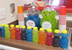Candyland Party: My FAVORITE part! Gummy bear juicie boxes! Love these honey containers! The big juice containers are animal cracker tubs from Target!