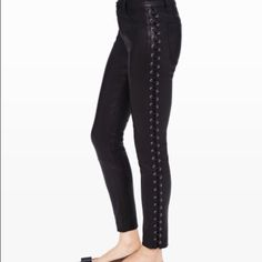"""Club Monaco Sabelle Leather Leggings Your favorite leather legging gets updated with bold side lacings. 100% Lamb Leather. Belt loops at waistband. Zip fly with button closure. Faux pockets at sides. Lace-up detailing at legs. Patch pockets at back. 32"""" inseam. Professional leather dry cleaning only.  SIZE 0- very stretchy I normally wear a size 2/4 and these fit perfectly so I think the 0 will fit a range of sizes.   Retails for $795 Club Monaco Pants Leggings"""