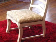 Learn how to revamp a chair the DIY way. A few yards of fabric, some sanding and a couple coats of paint are all it takes to make a kitchen or dining room chair look new.
