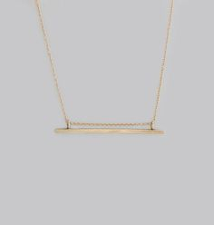 This Necklace is a refined take on the on-trend bar shape. Its thin silhouette lies gracefully on the neck, mimicking the geometry of the collar bones. Its design creates a subtle negative space, setting it apart from other bar necklaces. This Necklace represents balance and harmony.    16'' solid cable chain