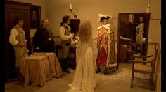 """Powerful scene near the end of """"La Nuit de Varennes"""" when one of the queen's servants, knowing that the royal family has been captured, places the king's clothes onto a mannequin and bows before it."""