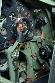 Inside a British Spitfire fighter, her instruments...