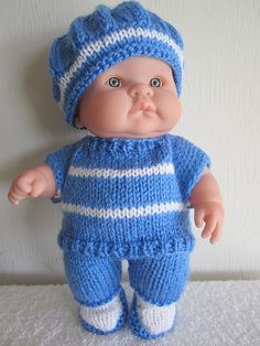 Perfect for boy doll outfit- pattern for hand knitting consists of top, pants, tam/beret and booties ~Now available as an instant download, you will be directed to download pattern after payment is made, check your etsy receipt for the link easy to knit- stitches used: knit, purl, inc, dec, yo/yfwd, psso, k2tog, k2TBL,p2tog, cable cast-on, pieces are knit flat and seamed, US knitting terms Materials: 1.75 oz. MC light/DK wt yarn yarn used-Lion Brand Jamie(new) Small amt CC yar...