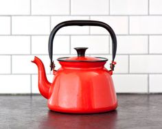 Hey, I found this really awesome Etsy listing at https://www.etsy.com/listing/198792470/red-enamel-teapot-vintage-kitchen-retro