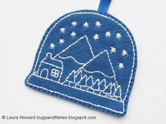Make an embroidered felt snow globe with this DIY Christmas ornament tutorial and free embroidery pattern.