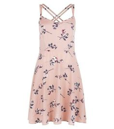 """Give this rose floral print strappy dress a laid back feel when paired with a white tee and trainers - great for your summer day look.- All over rose floral print- V neckline- Double shoestring straps- Fit and flare design- Casual fit that is true to size- Mini length- Model is 5'8""""/176cm and wears UK 10/EU 38/US 6"""