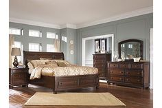"The Porter Sleigh Bedroom Set from Ashley Furniture HomeStore (AFHS.com). The warm rustic beauty of the ""Porter"" bedroom collection uses a deep finish and ornate details to create an inviting furniture collection that fits comfortably into any bedroom decor."