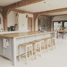 If your kitchen has a lot of exposed wood in it, think about counteracting it with light greys and whites that lighten it up Barn Kitchen, Kitchen Family Rooms, Open Plan Kitchen, Living Room Kitchen, Country Kitchen, New Kitchen, Barn Conversion Interiors, Barn Conversion Kitchen, Barn Conversions