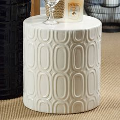 White earthenware stool with a geometric motif.