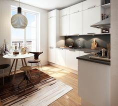 Wonderful blend of wood tones in a simple, cozy Scandinavian style kitchen.