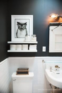 Paint makes a huge impact! This small black and white bathroom makeover is gorgeous, and all it took was a can of black paint! Brooklyn Limestone: Black and White Bathroom Mini Makeover Complete - Modern Bathroom Bathroom Wall Shelves, Bathroom Art, Bathroom Storage, Bathroom Ideas, Bathroom Renovations, Bathroom Small, Boho Bathroom, Tiny Bathroom Makeovers, Bathroom Designs