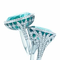 The quality of Tiffany's gemstones is unsurpassed, and the superb faceting radiates fantastic color with every gesture. Rings of oval green tourmalines, diamonds and platinum.