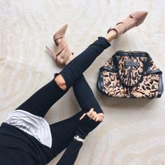 Click the photo to shop the look | Fashioned Chic Styling wearing black ripped skinny jeans, suede cut-out sandals, and a leopard print bag | Follow @liketoknowit on Pinterest for more outfit inspiration #liketkit