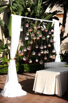 Hanging flowers! http://www.stylemepretty.com/california-weddings/2015/02/02/sunset-inspired-newport-wedding/   Photography: Gavin Wade - http://gavinwadephoto.com/