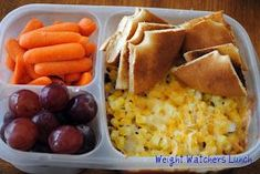 360 Lunch Boxes: Weight Watchers Lunch | In the large compartment, I layered 1/2 cup fat-free refried black beans, 1/4 cup salsa, 1/4 cup chopped onions; 1/2 cup corn; and 1/3 cup 2% cheese. I toasted a Bagel Thin and sliced it into fourths for dipping. I cut up 14 baby carrots and 1 cup purple grapes.
