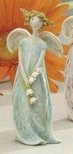Angel holding Lily of the Valley flowers. Paper Mache Sculpture, Sculpture Art, Sculptures, Ceramic Figures, Ceramic Art, Pottery Angels, Clay Angel, Angel Artwork, Ceramic Angels