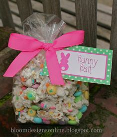 Bunny Bait_  Supplies: Rice Chex, pretzel sticks, white melting candies, spring sprinkles, white pop corn and M&M's Spread 2 cups pretzel stick, 2 cups Rice Chex and 1 bag white popcorn on cookie sheet. Pour melted white melting candies over mixture and stir to coat.  Then sprinkle on your spring sprinkles.  Do not mix after sprinkling or you will coat the sprinkles. Once the mix is set, add M&M's and then package for neighbors, for a party or in individual treat bags.