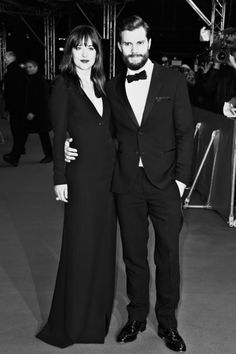 Dakota Johnson and Jamie Dornan Photos - Image has been converted to black and white)  Actress Dakota Johnson and actor Jamie…