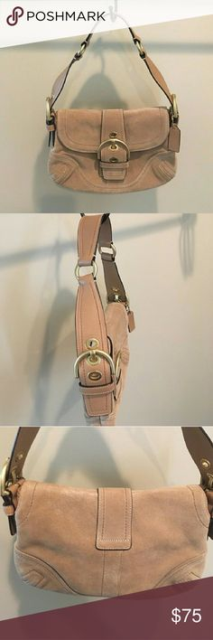 """Suede coach purse Worn once. Still like new, no flaws. Beautiful light tan suede Coach over the shoulder purse with front buckle. Magnetic closure. Aprox 7"""" tall and 10"""" accross. Cream colored inner lining. Interior zipper pocket & side pockets. If you have any questions. I'm happy to answer :) Offers are welcome. coach Bags Shoulder Bags"""