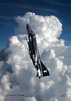 This is a great sot of a black F4 Phantom against the clouds.