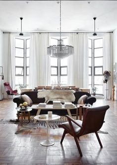 The glam art deco living room can boast of a Swarovski crystal chandelier, floor-to-ceilings windows that let in light and fur furniture covers for a glam touch