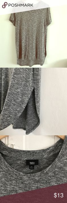 Mossimo Gray Tee with Side Slits Cute long gray tee with side slits from Mossimo. This heathered gray, super soft tee has a loose, easy fit and is cut long, so it's great over leggings or high-waisted shorts. Length is a little longer in the back. The slits give it a fun detail. Perfect for upcoming music festivals-- pair it with a pair of distressed cutoff shorts, combat boots, and a felt hat for a fierce festival vibe! Worn twice and in excellent condition. Rayon/poly/Spandex blend is…