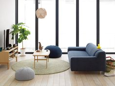 Examples of coloured furniture in earthy hues to contrast the wood elements.
