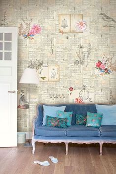 Book page wallpaper. craft room or reading nook! Fabulous sofa too!