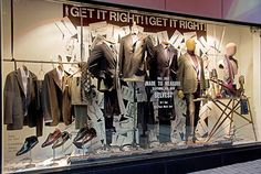 the men's clothing store displays, pinned by Ton van der Veer.