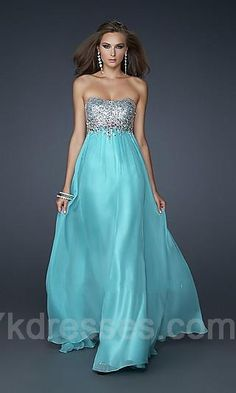 Very simple dress. love! Color, strapless, long and flows. With a little something more to the top. Absolutely beautiful. I would definitely wear this
