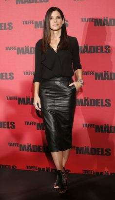 Check out this affordable black leather skirt rocked by Sandra Bullock!