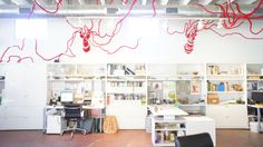 This is the interior of design and landscaping firm Big Red Sun located on Cesar Chavez in East Austin. The beautiful yarn deer are made by Elaine Bradford. Cesar Chavez, Landscape Services, Red Sun, Inspiration Boards, Bradford, Offices, Service Design, Deer, Landscaping