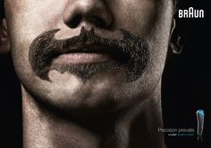 1.) Razor and BRAUN 2.) Precision Prevails 3.) Macho and humor. The ad shows a mustache which is usually considered manly. The mustache is in the shape of batman which is a crazy mustache.  4.) The age group is probably for young adult males. (18-30 years old) 5.) The ad is intended to entertain 6.) This is a good ad because it gives the customer something they can easily recognize. 7.) Derry §.