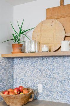 Concrete countertop,  faded-look 12x12 backsplash tiles,thick open shelves (Patti Baker home, Fixer Upper)