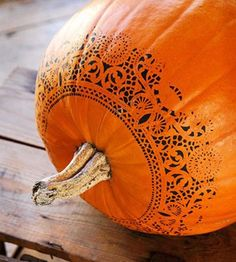 Spray paint + doilies + pumpkins