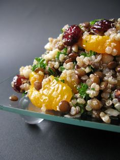 2 cups h20 1/2 cup lentils 1/2 cup quinoa ¼ cup canola oil 4 Tbsp. cider vinegar 1 Tbsp. lime juice 1 can mandarin oranges, reserving 3 Tbsp. juice 1/4 Tbsp. salt  1/2 cup almond slivers 1/2 cup dried cranberries 3 Tbsp. chopped fresh parsley