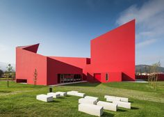 Art and culture centre with bright red walls by Future Architecture Thinking