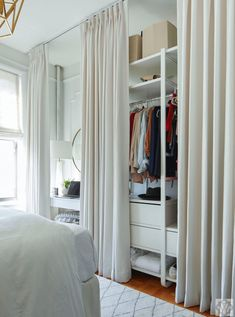 Hidden storage behind beautiful Fabricut Quick-Ship draperies creates an instant closet and vanity area for a bedroom that lacked a closet. Designed by Dana Wolter Interiors; Photography by John Bessler Small Space Living, Small Spaces, Small Living Room Storage, Closet Curtains, No Closet Bedroom, Master Closet, Curtain Wardrobe, Small Wardrobe, Sliding Wardrobe
