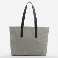 Our Zip Tote now in a beautiful, sturdy twill fabrication 100% cotton twill exterior Leather straps and gunmetal zip-top closure 100% cotton twill…